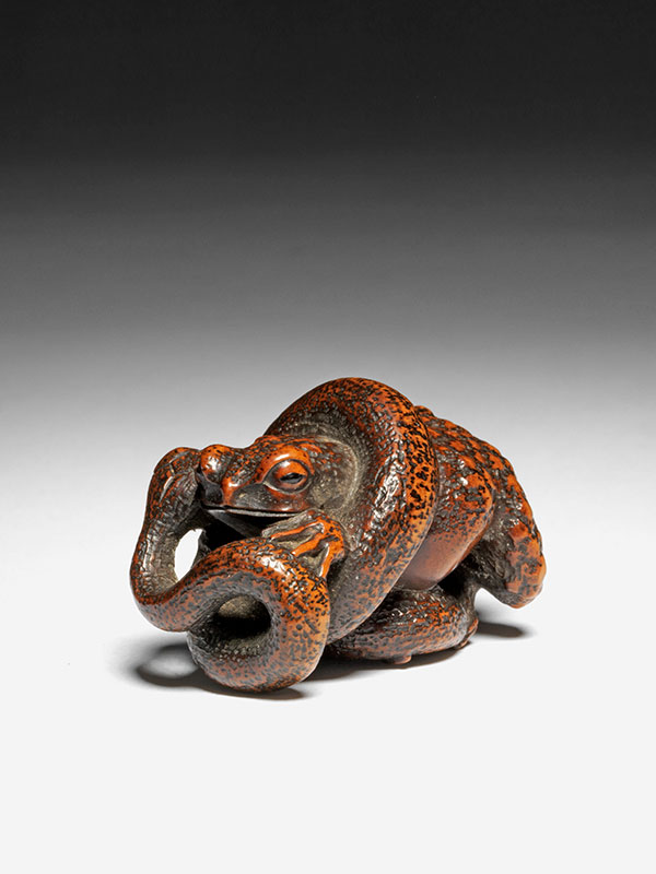 Masanao - wood netsuke of a snake and toad locked in mortal combat