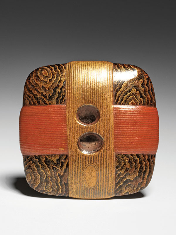 A flattened wood square serving as a silk spool