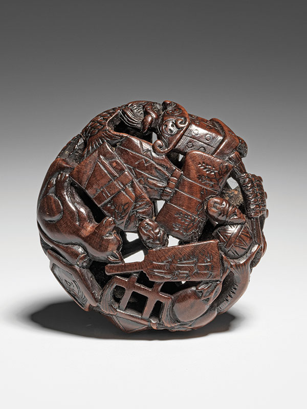 A ryusa style wood manju densely carved with toys