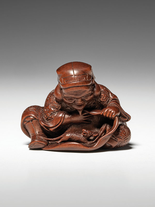 Daikoku, the God of Wealth laughs with delight