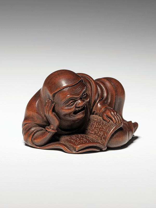 Daruma reclines on his side