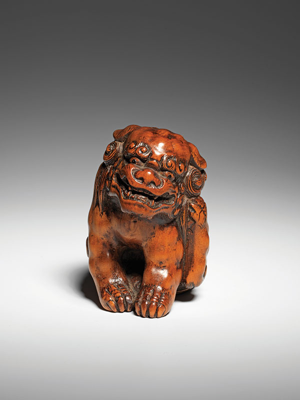 A large seated shishi