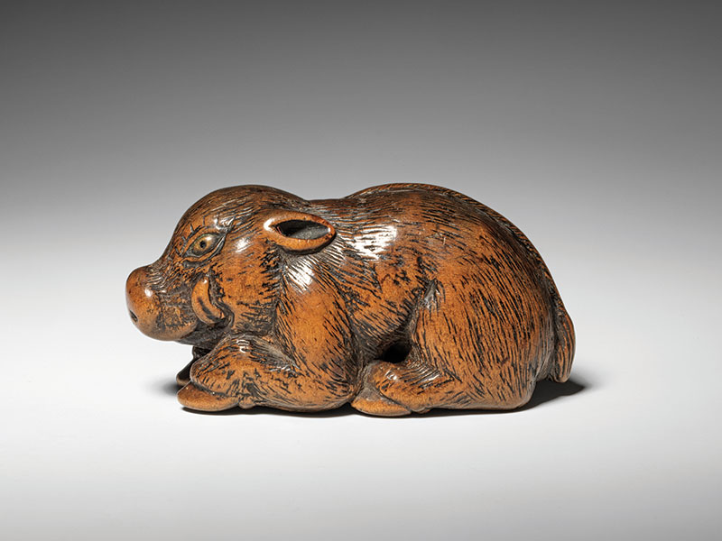 A large wood reclining boar