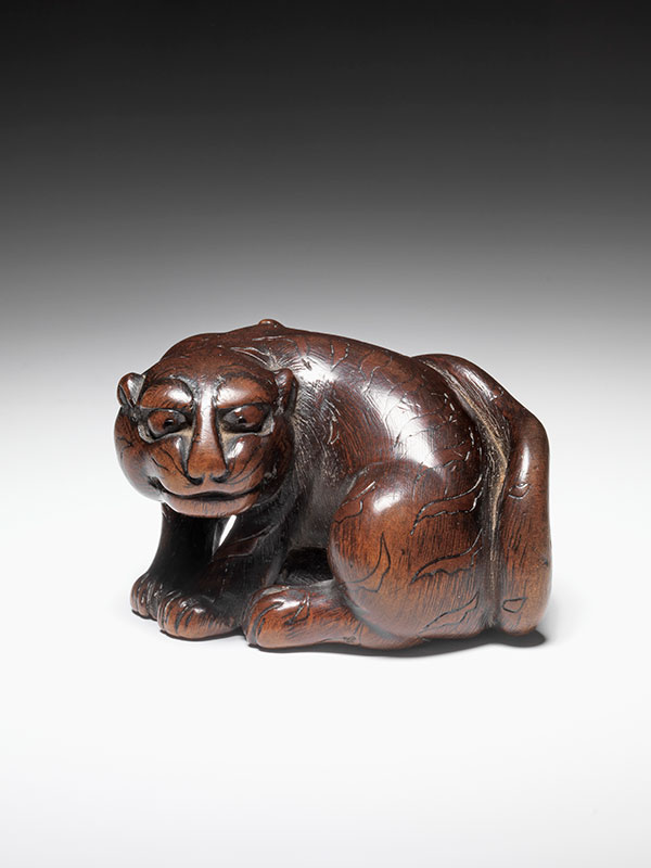 Unsigned wooden tiger netsuke