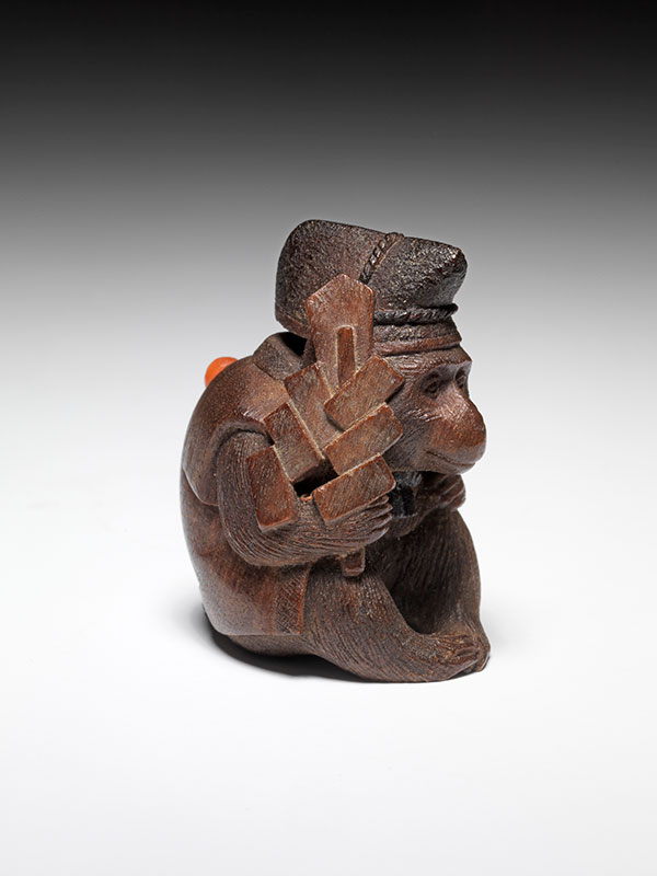 Inada Ichiro miniature wood netsuke of a monkey entertainer