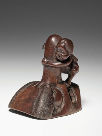 Okame with long nosed mask - unsigned netsuke