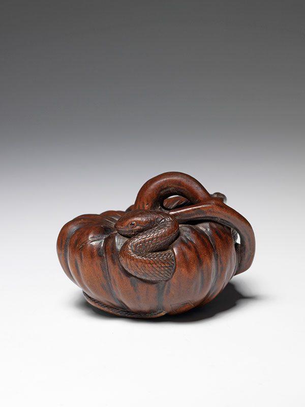 Tadayoshi snake in a gourd netsuke