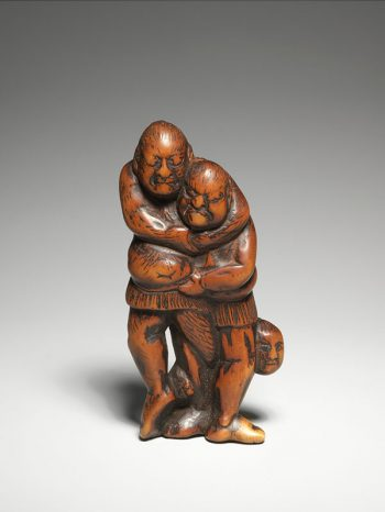 Unsigned mingei (folk art) wood netsuke depicting two wrestlers