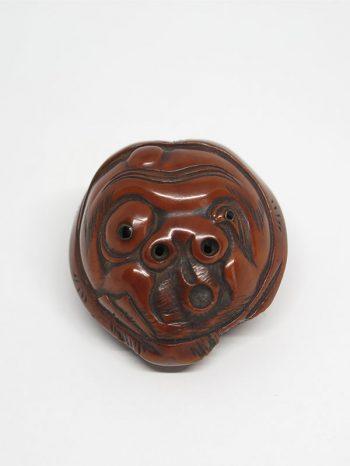 Gyokuzan - kurumi carved as a mask of Usobuki