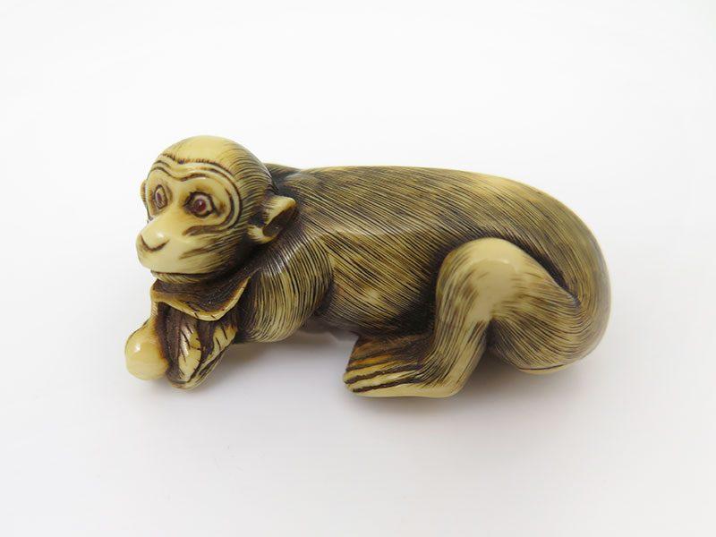 Unsigned netsuke of a reclining monkey