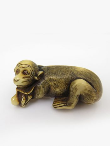 Unsigned ivory netsuke of a reclining monkey