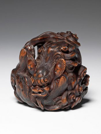 Masakata - wooden netsuke of two fighting shishi